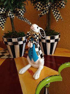 This is a small version of the big white rabbits I sell here on Etsy. It would be a perfect gift for a friend who loves Alice in Wonderland! While he may be small in stature (6), he is not small in character! He is sporting a black and white checked hand painted jacket and peacock blue vest and you will love his big feet and ears! I can do the best in blue, lime green or purple. This will be painted to order so please allow up to a few weeks before it will be shipped.
