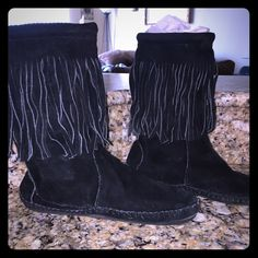 """SALE Vintage 100% Suede moccasin boots Black fringe all suede moccasin boots.  They wrap around the ankle/calf and have a Velcro and suede tie closure on the outside of each boot.  The boots have a 10"""" shaft.  Gently loved but other than slight wear on sole, near flawless! Boutiqe Shoes Ankle Boots & Booties"""