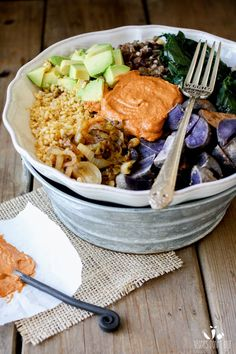 Barbecue Tahini power bowl with spinach, swiss chard or kale and potatoes, beans, brown rice, spring onions and avocado