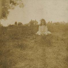 Little girl in a graveyard, circa 1900