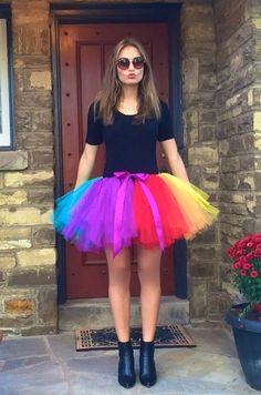 This handmade beautiful adult rainbow tutu is made with lots and lots of gorgeous tulle and ribbon. Very poofy! Very adjustable. It will fit most. Perfect for Pride. You will be ver happy with yours. If you like this, order right away! Christmas is pretty slow for mail! It takes me around 3 business days to make a tutu and it takes approx 7 business days to get to most places in North america.