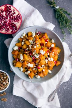 A side dish worthy of center stage: deliciously roasted butternut squash tossed with gorgonzola, pecans, and pomegranate!