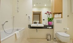 molo residence sopot Boutique Hotels, Bathroom Lighting, Bathtub, Mirror, Furniture, Home Decor, Bathroom Light Fittings, Standing Bath, Bathroom Vanity Lighting
