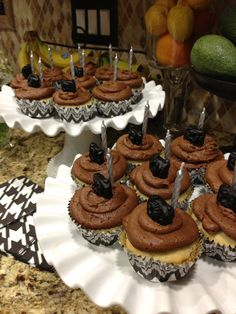 Choc chip banana cup cakes with choc frosting and choc candy clay cameras.