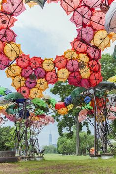 """Izaskun Chinchilla Architects imagined and created the """"City Of Dreams Pavillon"""" in Governors Island in New York. Landscape Architecture, Landscape Design, Nachhaltiges Design, Colorful Umbrellas, Pavilion Design, Natural Structures, Shade Structure, Fabric Structure, Decoration Inspiration"""