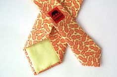 PINA COLADA - Nothing like a Pina Colada on a hot summers day. Red pineapple and banana detailing on a yellow background, this tie will remind you of greener pastures while stuck in the office