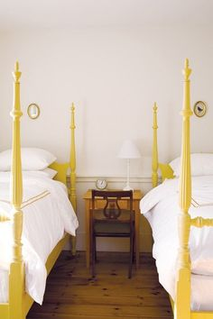 yellow four poster beds