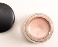 """MAC Vintage Selection Pro Longwear Paint Pot ($18.50 for 0.17 oz.) is described as a """"frosted dirty peach."""" It's a subtly, warm-toned, lightened brown with a slightly frosted, champagne sheen. Make Up For Ever #13 is less warm-toned. Benefit RSVP is also similar. bareMinerals Libation is very similar but a powder product."""