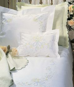 Sferra Sweet William - The charming femininity of hand-embroidered soft pastel bouquets, gathered with pale blue bows, enchants our white Italian Egyptian cotton percale sheeting. Also available in White on White, both with a border of hand drawn hemstitching and a classic, tailored flange. In sheets, duvet covers, pillowcases and shams, and bed skirts with a plain hem. Woven to 406 threads per square inch HAND EMBROIDERED PERCALE ITALIAN EGYPTIAN COTTON, Woven in Italy.