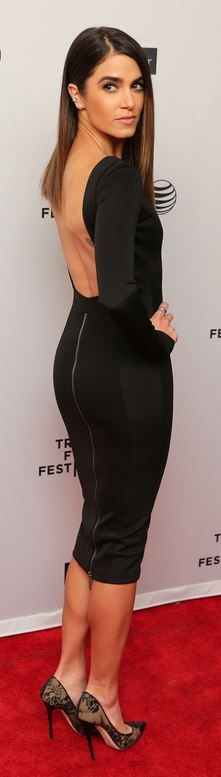 Who made Nikki Reed's long sleeve backless dress, clutch handbag, and black lace cap toe pumps that she wore in New York?