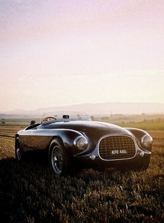 1951 Enzo Ferrari 212 Touring Barchetta. Large radiator grills once a necessity, now back in fashion.