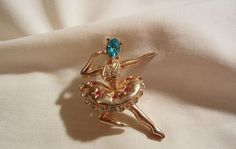 She's a truly lovely vintage Ballerina with a small oval shaped aqua color rhinestone on face and pave set clear rhinestones on body and edge of
