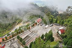 Mountainous view of Genting Highlands (Malaysia) on a sunny day, with a view of…