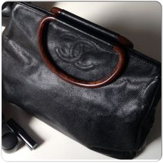 AUTHENTIC & VINTAGE BLACK CHANEL CAVIAR TOTE Authentic black caviar tote with resin handles that resemble wood!  The bag has inside zippered pocket, matching COA & dust bag. The inside lining is black faille and clean. There is some slight fading to the corners as shown in the photos. This bag needs to be used so it can conform to the shape of normal use. Due to the skin & creasing, the bag is not overly attractive unless its being used. It is basically a sack of skin with wrinkles unless…