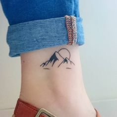 Any nature-lover will love this mountain scene tattoo. It's so minimalist! Via: marionnpn/Instagram