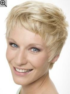 Short layered hairstyle with a side part and bangs. Sunny blonde hair with lighter strands.