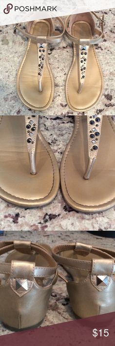Gold sandals!  Size 8, really good condition. Only real flaw is shown in the 4th pic. A tear in the strap that buckles. Lots of life left!! Mossimo Supply Co. Shoes Sandals