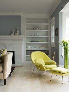soft gray-blue, white & natural woods, with a pop of yellow Saarinen Womb Chair 1948.