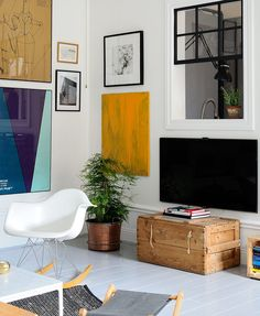a chest as tv stand + corner gallery wall