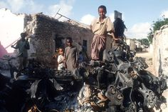 the battle of mogadishu | Children stand on top of the wreckage of an American helicopter in ...