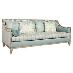 """Eclectic and elegant, this wood-framed sofa showcases multipattern upholstery for eye-catching style.    Product: SofaConstruction Material: Fabric and woodColor: Cream, blue and beigeFeatures: Multipattern upholstery Carved details         Dimensions: 36.5"""" H x 86.25"""" W x 37.25"""" DAssembly: Simple assembly required"""