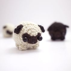 """Little pug is a funny thing.This cute pug amigurumi is nice and squishy, and makes a good gift for someone who likes pugs.You can choose to have a fawn colour or black pug. It can also be made into a keychain or hanging ornament.This amigurumi dog is crocheted using wool yarn, and is about 4 cm / 1.6"""" wide.M�hu's crocheted animals are intended as collectible plush toys, and shouldn't be given to children."""