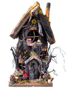 gnome home or fairy house - I got several for my Granddaugthers and made a little fairy land on large pices of plywood covered with moss - for their Disney Fairies and made bird baths and toadstools and little pond - they love it....whimsicalwoods.net