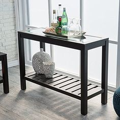 #helpinghand The design of the #Sutton Glass Top Console Table with Slat Bottom, and its undeniably chic aesthetic, provides the ideal update for the living room...