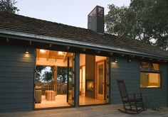 A modern dogtrot with a fireplace.