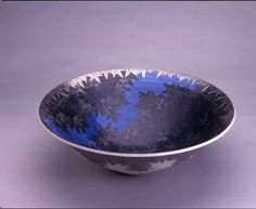 Porcelain bowl with maple leaf motif in black, blue and silver.  Artist: Imaizumi Masato  Region: Arita and Karatsu