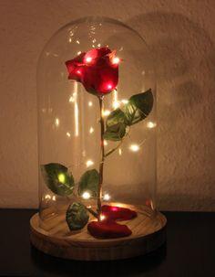 """Selbst gebastelte """"Verzauberte Rose"""" aus die Schöne und das Biest. Glasglocke von Ernsting's Family (Reduziert auf 6,99€), Kunstrose von IKEA (1,99€) und LED-Lichterdraht, batteriebetrieben (1,99€). Zusätzlich noch Streudeko-Kunstrosenblätter auf den Teller legen. Ein echter Blickfang!"""