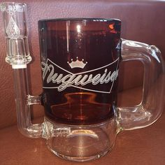 """If you're a fan of the king of beers  why not try out the king of glass ! The """"Nugweiser""""  brought to you by @hightechglass has a handle just like a cold mug of your favorite brew that allows you to have a convenient grip. The mug also features an inline perc making it hit as smooth as your brew would! by savsmokecartel"""