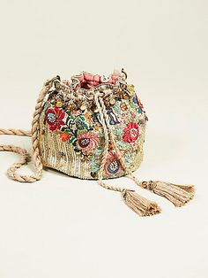 Pinki Embellished Pouch  | Easily go from day-to-night with this beautifully embellished boho bucket bag featuring rows of metallic sequins and floral embroidery with bead and sequin dealing. Gold metallic long strap and a drawstring closure.