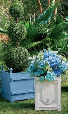 The boxed planters of the Orangerie and gardens at the Palace of Versailles have been icons since Louis XIV began his orange tree collection in 1663. We have replicated the famed design with our exclusive cast-aluminum Versailles Planter, versatile enough for citrus trees, olive trees, boxwood (especially topiary), or large plants. Perforated bottom for drainage. Citrus Trees, Palace Of Versailles, Louis Xiv, Large Plants, Olive Tree, Topiary, Planters, Garden Oasis, Icons