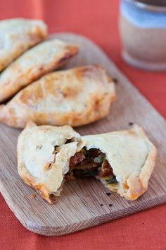 Chorizo Empanadas   By: fiveandspice   For parties, I especially love little self contained finger foods - turnovers, handpies, empanadas, things in little cups...They're portable and easy to eat, and you don't have to worry about double dipping! These little empanadas were created mostly by virtue of what was sitting in my fridge and a vague memory of a chorizo sandwich I once saw. They turned out delicious! Flaky, a little spicy, and bursting at the seams with flavor.   From: food52.com