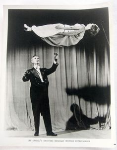 magician thats the way to sweep a girl off her feet,circus performer vintage photo