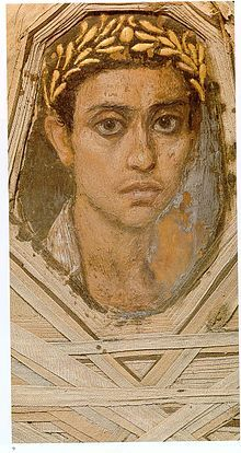 Detail of a portrait within its mummy wrappings, Metropolitan Museum of Art. It was discovered by Flinders Petrie in a burial chamber in 1911.