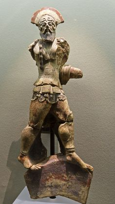 Etruscan painted terracotta acroterion of a warrior, from Caere | ca. 510 BCE From the Vigna Marini-Vitalini urban sanctuary, Caere.