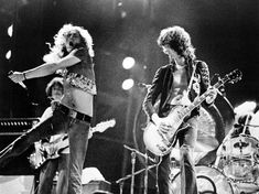 Robert Plant and Jimmy Page of Led Zeppelin - 1973 Robert Plant, El Rock And Roll, Rock And Roll Bands, Jimmy Page, Blues Rock, Led Zeppelin, David Byron, Great Bands, Cool Bands