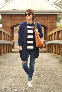 Cute and casual fall outfit idea via Peaches In A Pod blog. Women's fall fashion with navy blue cardigan, Chuck Taylor sneakers and distressed denim.