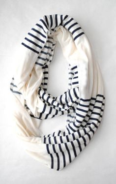 I saw this picture a while ago on Pinterest - of what I assume is a store bought scarf. I didn't pin it at the time but kept it in mind to try to do myself. I've recently cleaned out some old clothes getting them ready for Good Will and came across an old white T-shirt and a pair of cotton pj pants with cute pink hearts. I cut one into 4 and one into 5 rectangle sections and sewed them into an infinity scarf that looks like the one above. Such a great way to upcycle old clothes!