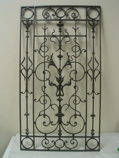 Cast iron gate door abrasive blasted and powder coated looks like it's brand new.