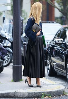 Effortless chic in navy blouse , black pleated skirt & black pumps #StreetStyle