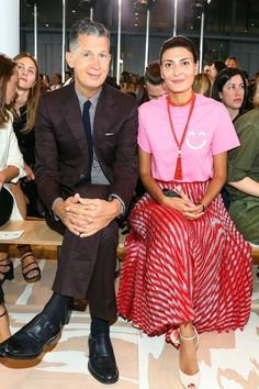 Stefano Tonchi & Giovanna Battaglia front row during NY Fashion Week. We love Gio's idea of pairing a bright tee with a cool, on-trend midi skirt. The look comes off easy breezy and very It girl.