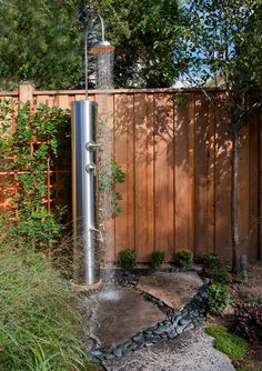 Or accentuate the plumbing as an architectural element. This steel column has heft and style. Bonus outdoor shower tip: Add a second faucet down low for rinsing off sandy feet.