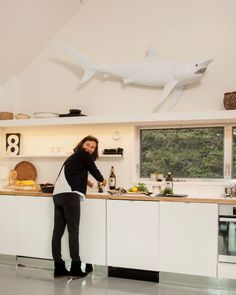 This kitchen is kitted out with a shark sculpture.