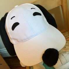 Easy Snoopy costume from a white baseball cap, fleece ears and a pompom nose
