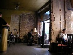 Keep the brick, faux finishing/ light wash in spots to add subtle age and reflect light.  [Berlin, Kreuzberg, Cafe Luzia]