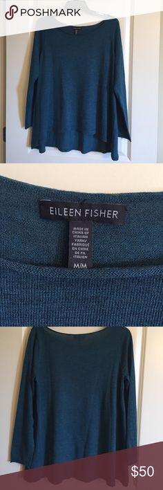 Eileen fisher light sweater medium This is a beautiful sweater. Blue/green teal color.  Non smoking home.  Worn once on a cruise.  Very good condition. Material says Italian yarn. Eileen Fisher Sweaters Crew & Scoop Necks