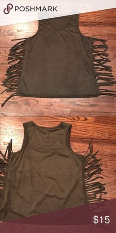 Olive Fringed Tank Top Faux Suede Olive scoop neck tank top with fringe details on the side seams. Great tank for summer with details that are easy to dress up or keep casual. 95% Polyester / 5% Spandex blend. Tops Tank Tops